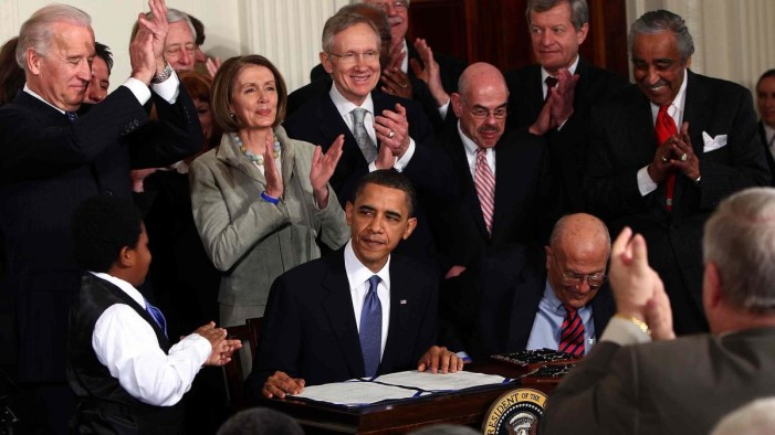 bill-signing-obamacare
